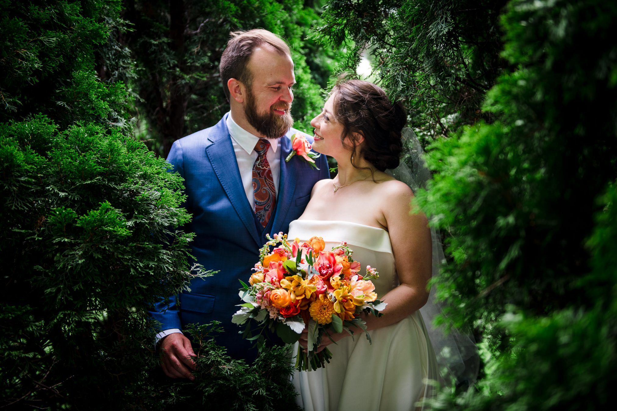 bride and groom in pine trees