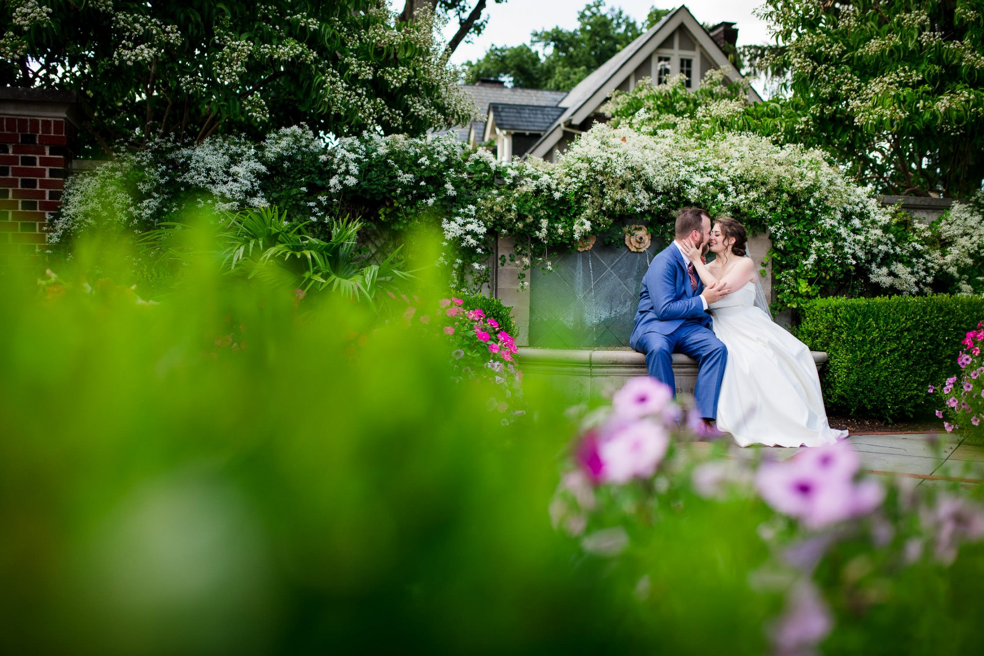 bride and groom in flower courtyard