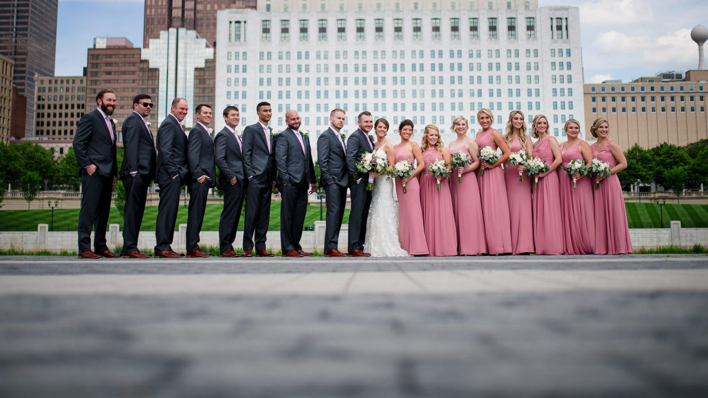 bride and groom with bridal party urban portrait