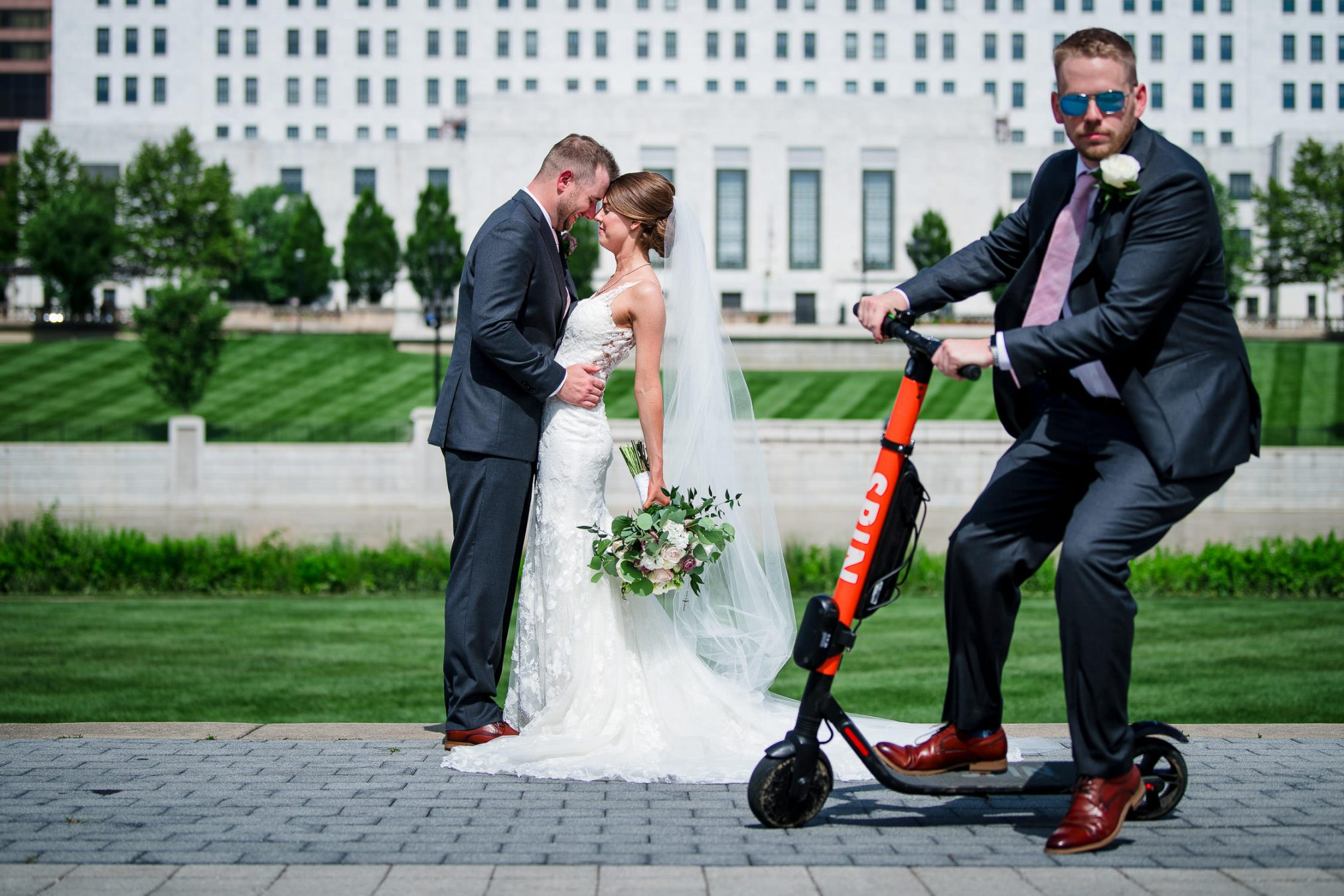 bride and groom on wedding day with scooter