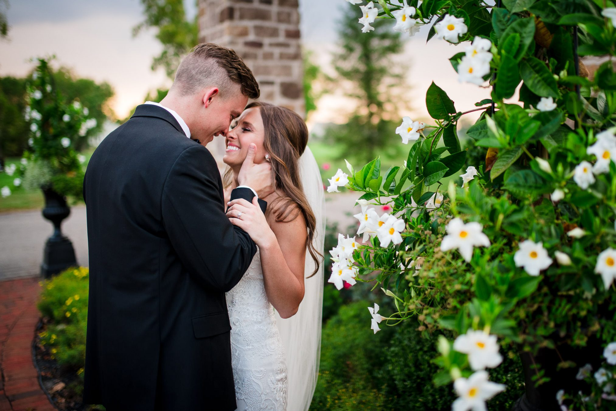 bride and groom kissing during spring wedding