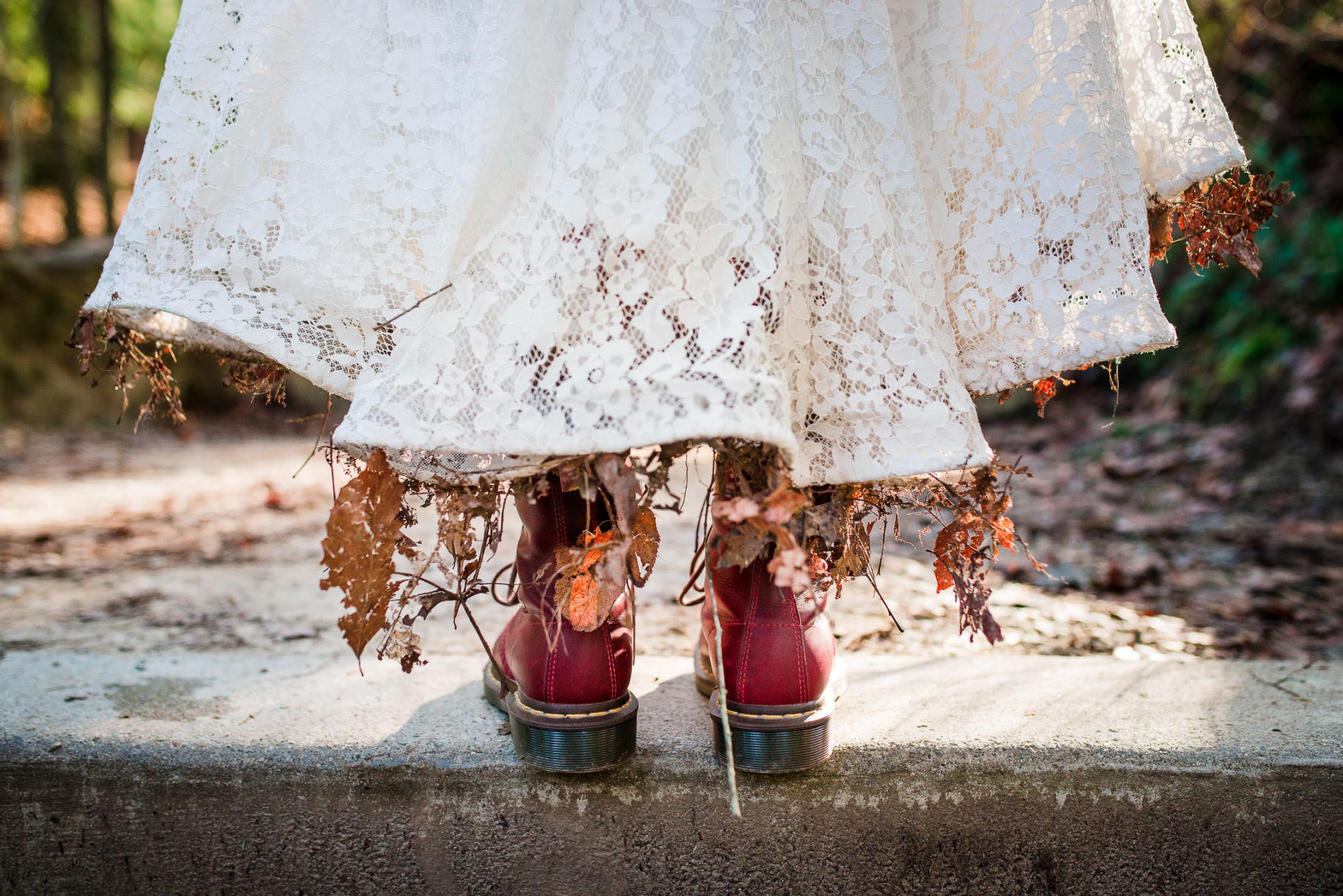 wedding dress with boots and leaves