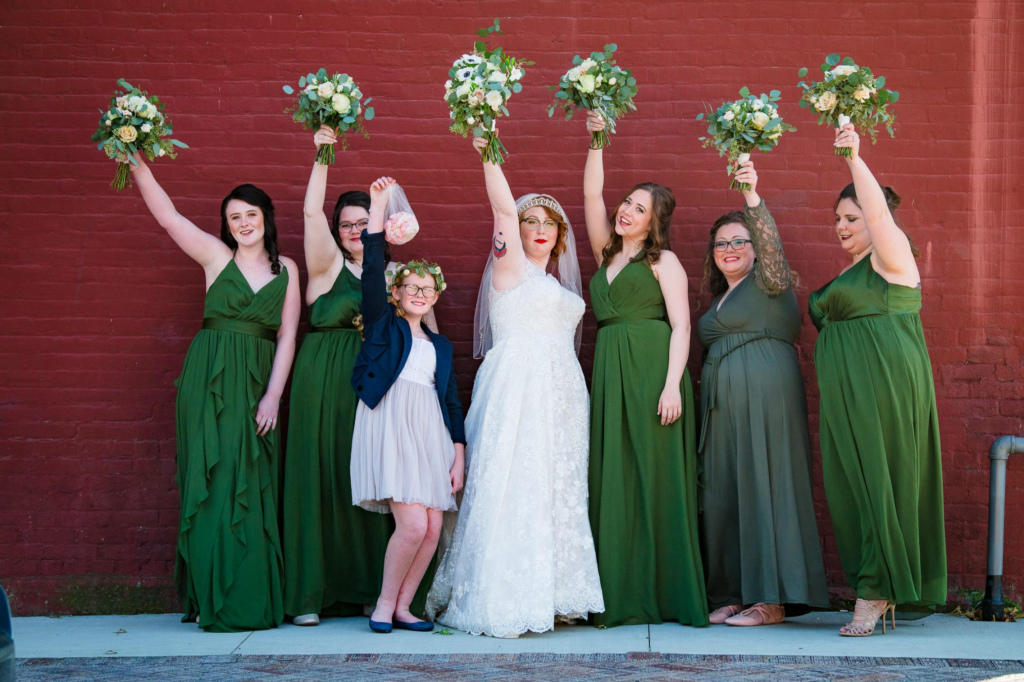 bride and bridesmaids with flower bouquets