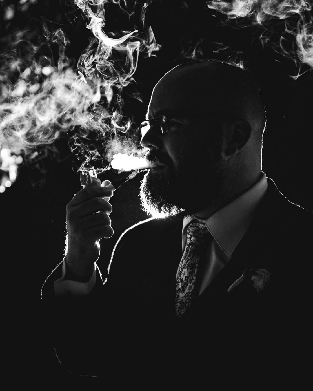 groom smoking creative portrait