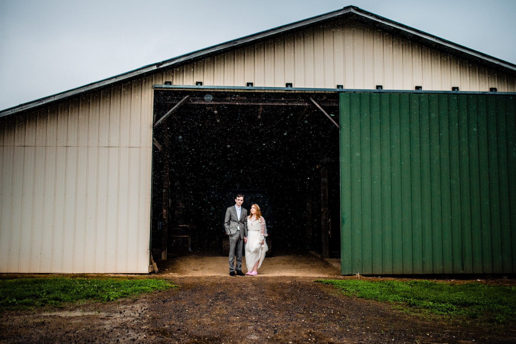 bride and groom backyard barn wedding