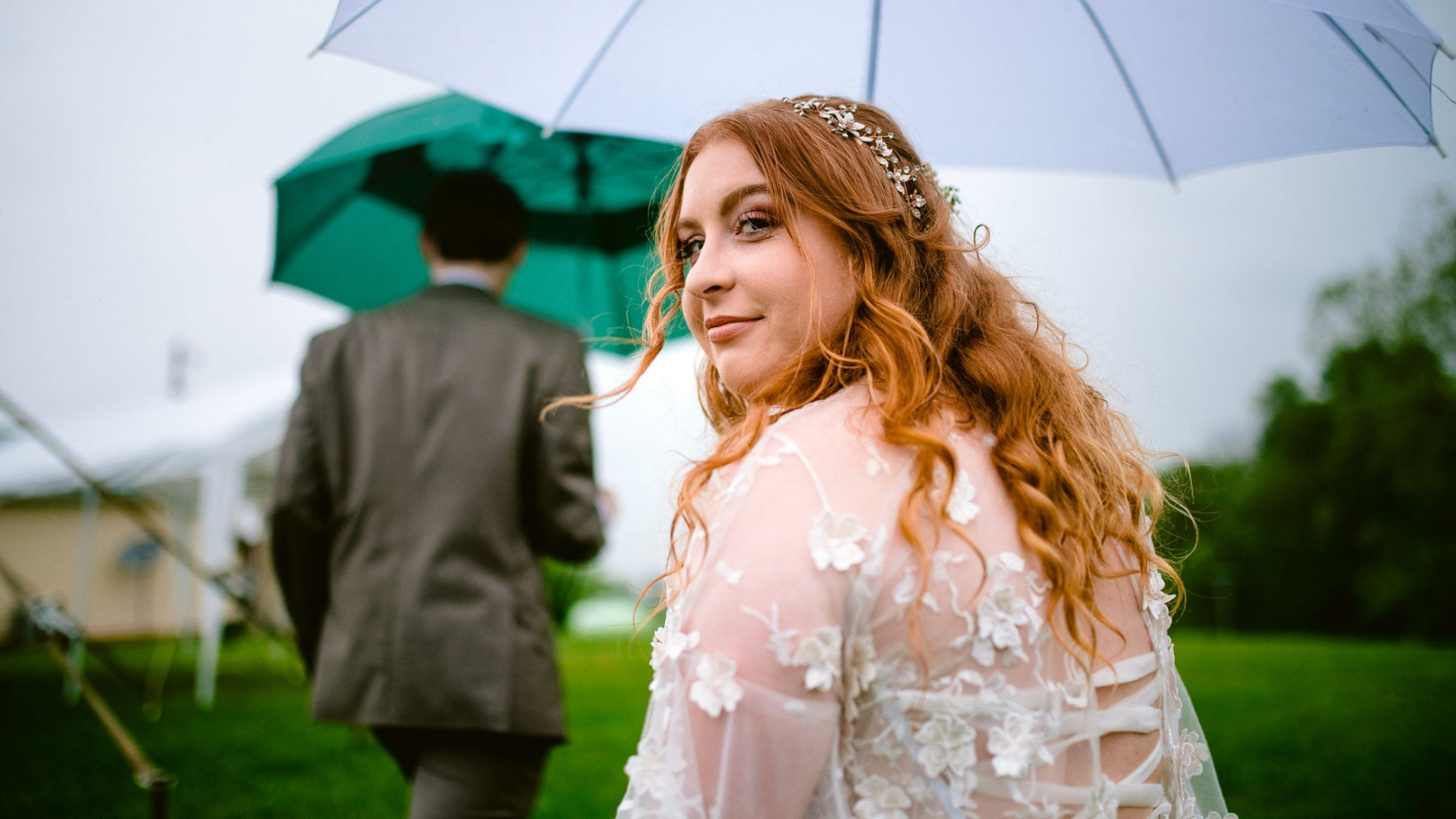 red headed bride under umbrella