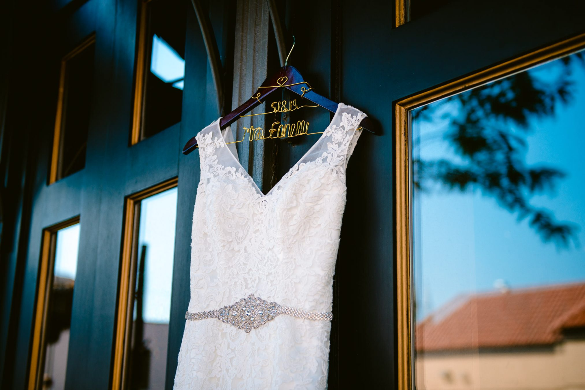 wedding dress in front of windows