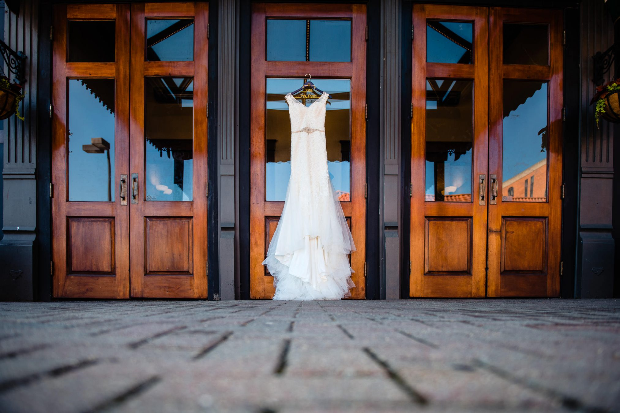 wedding dress in front of historic hotel