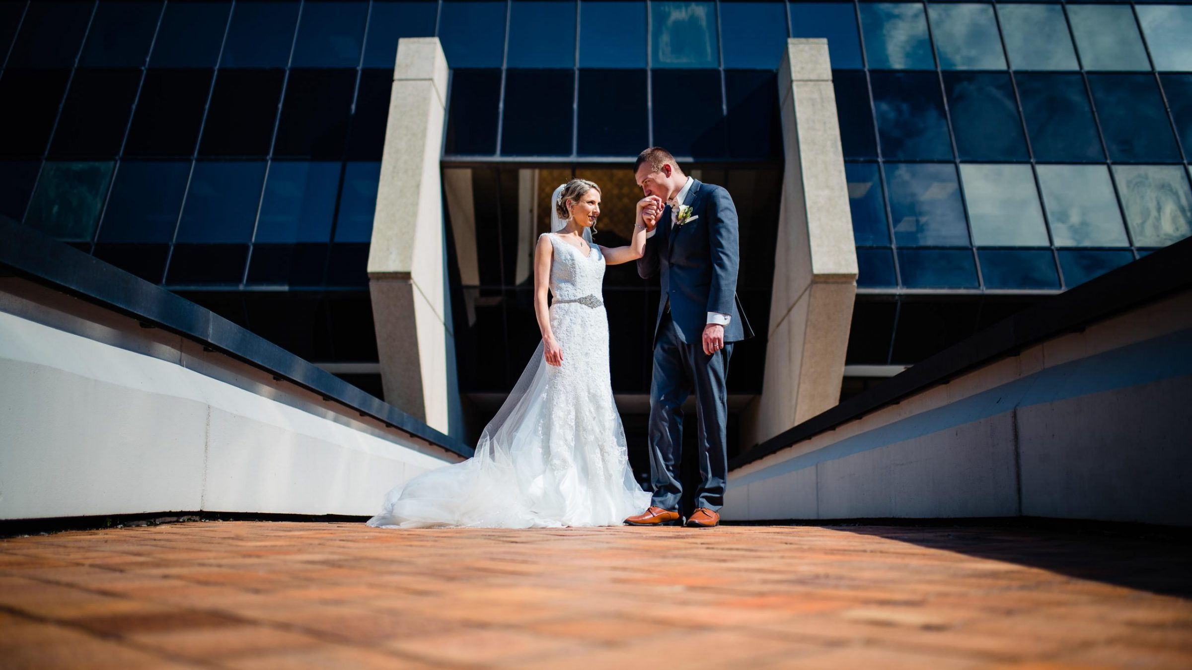 bride and groom with creative architecture