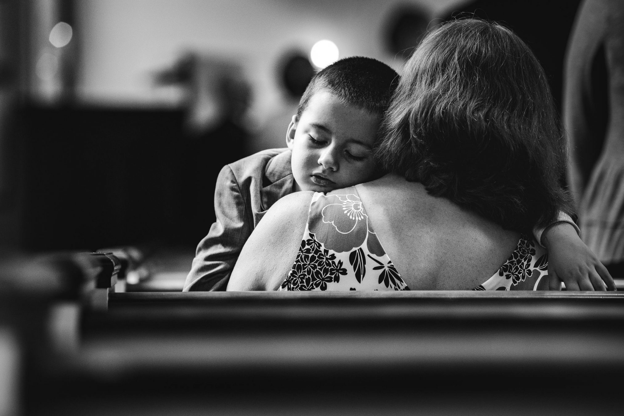 child asleep in church pew at wedding
