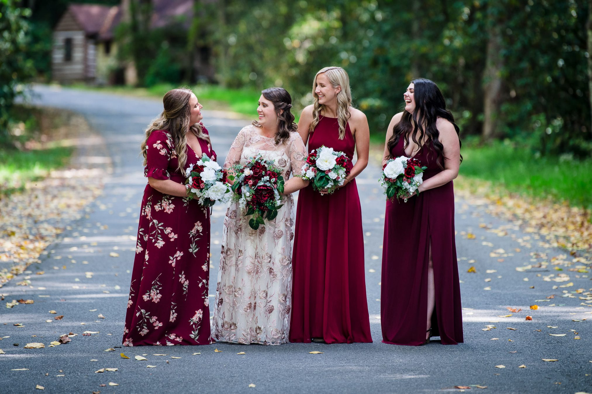 bride and bridesmaids on a fall road
