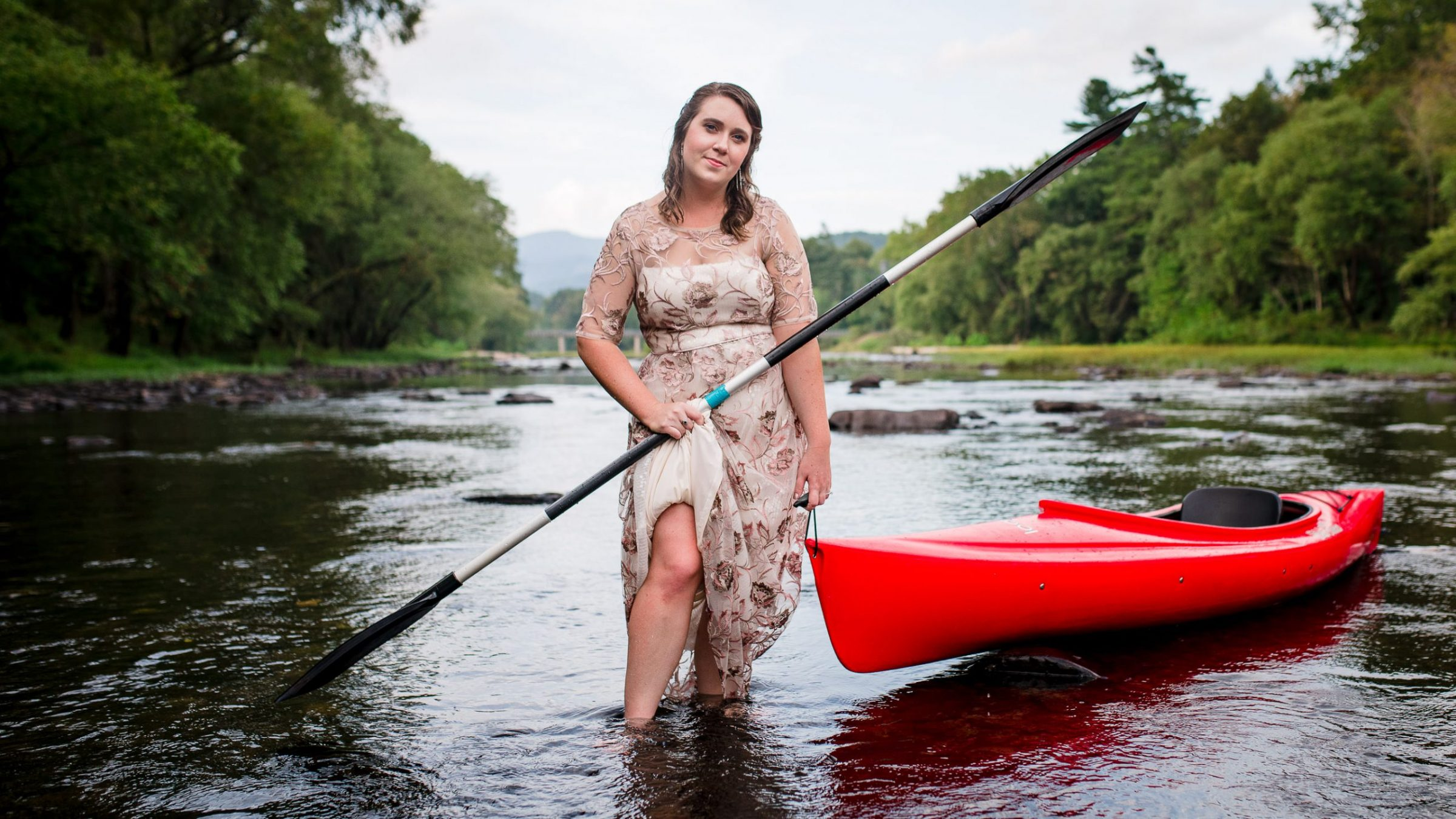bride kayaking on wedding day