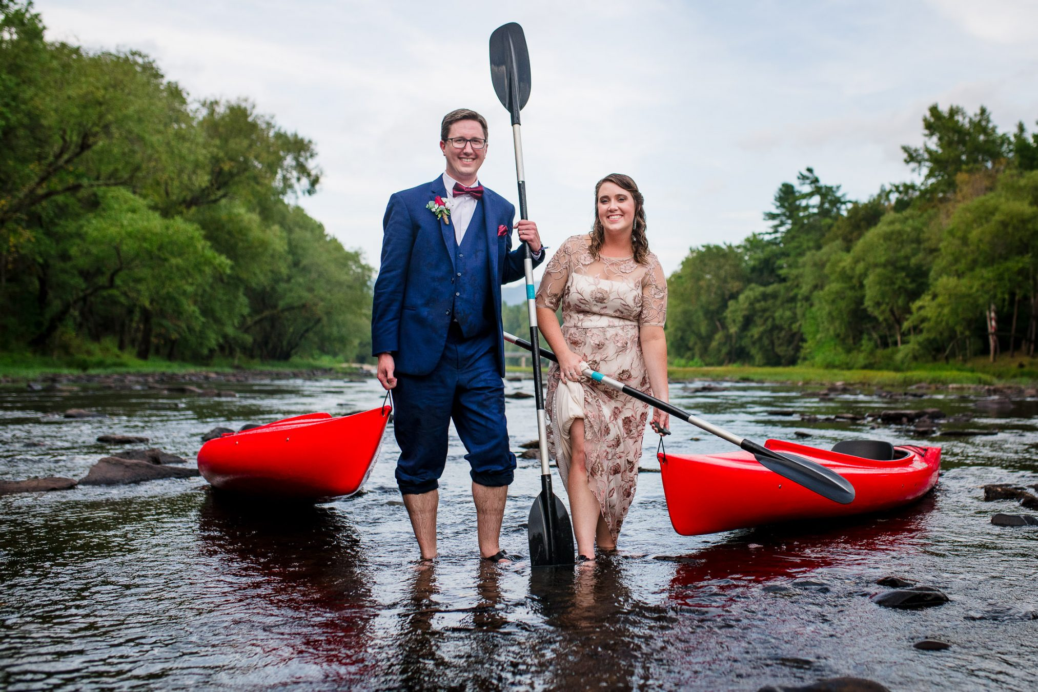 bride and groom kayaking on wedding day