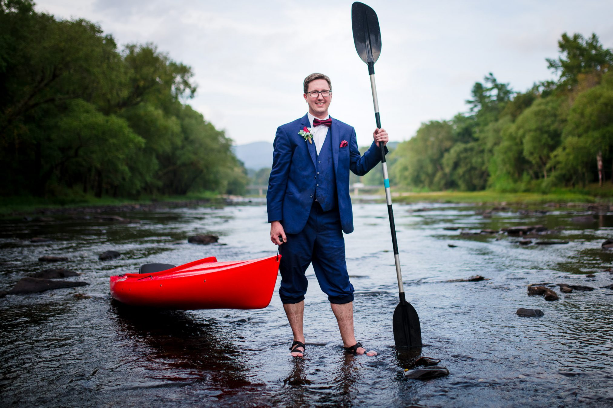 groom kayaking on wedding day