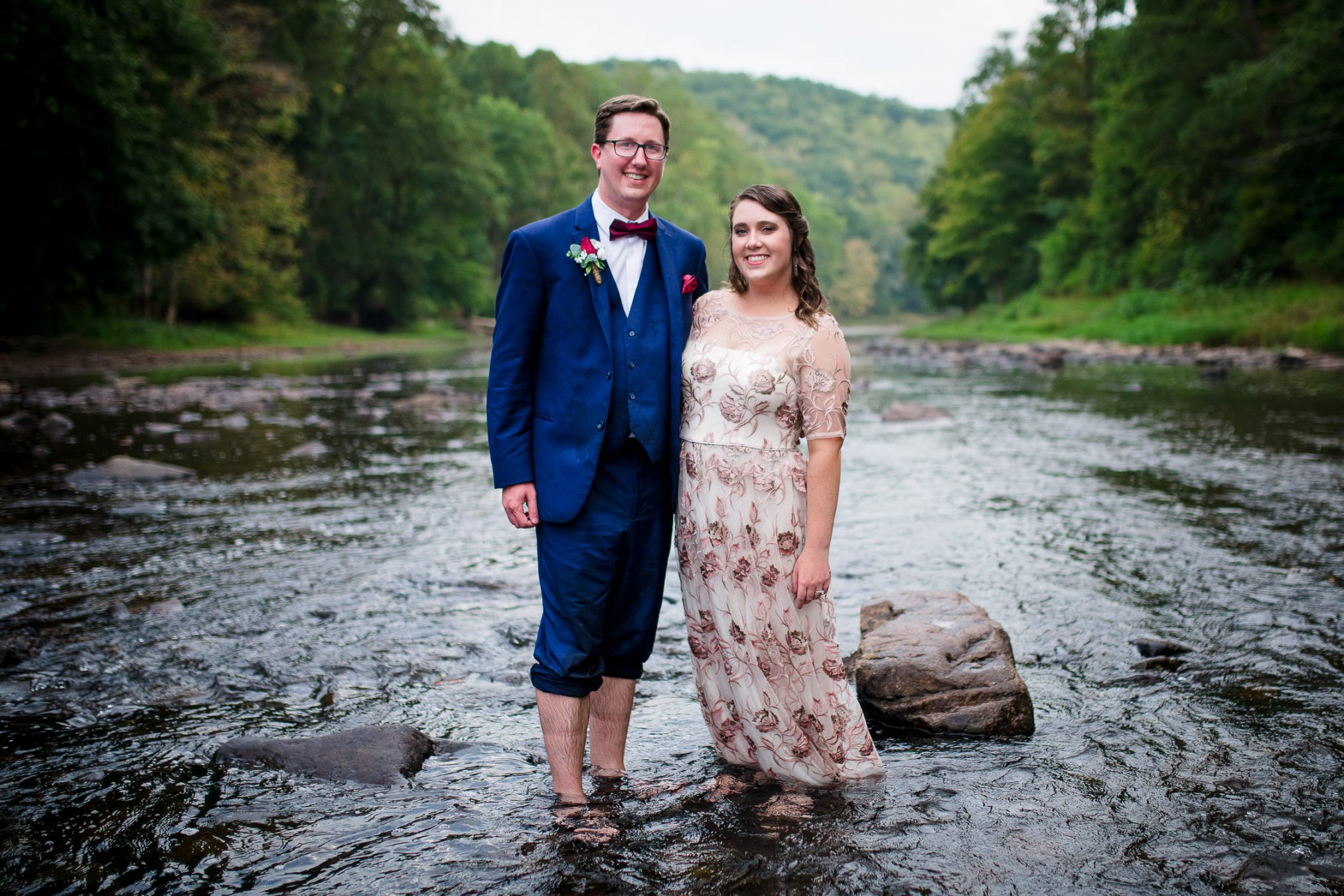 bride and groom married in river