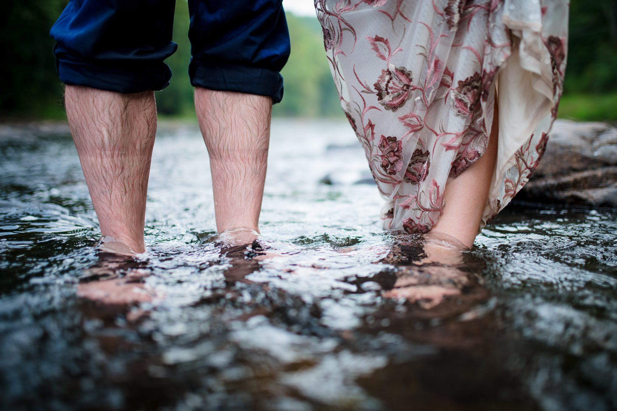 bride and groom with feet in water