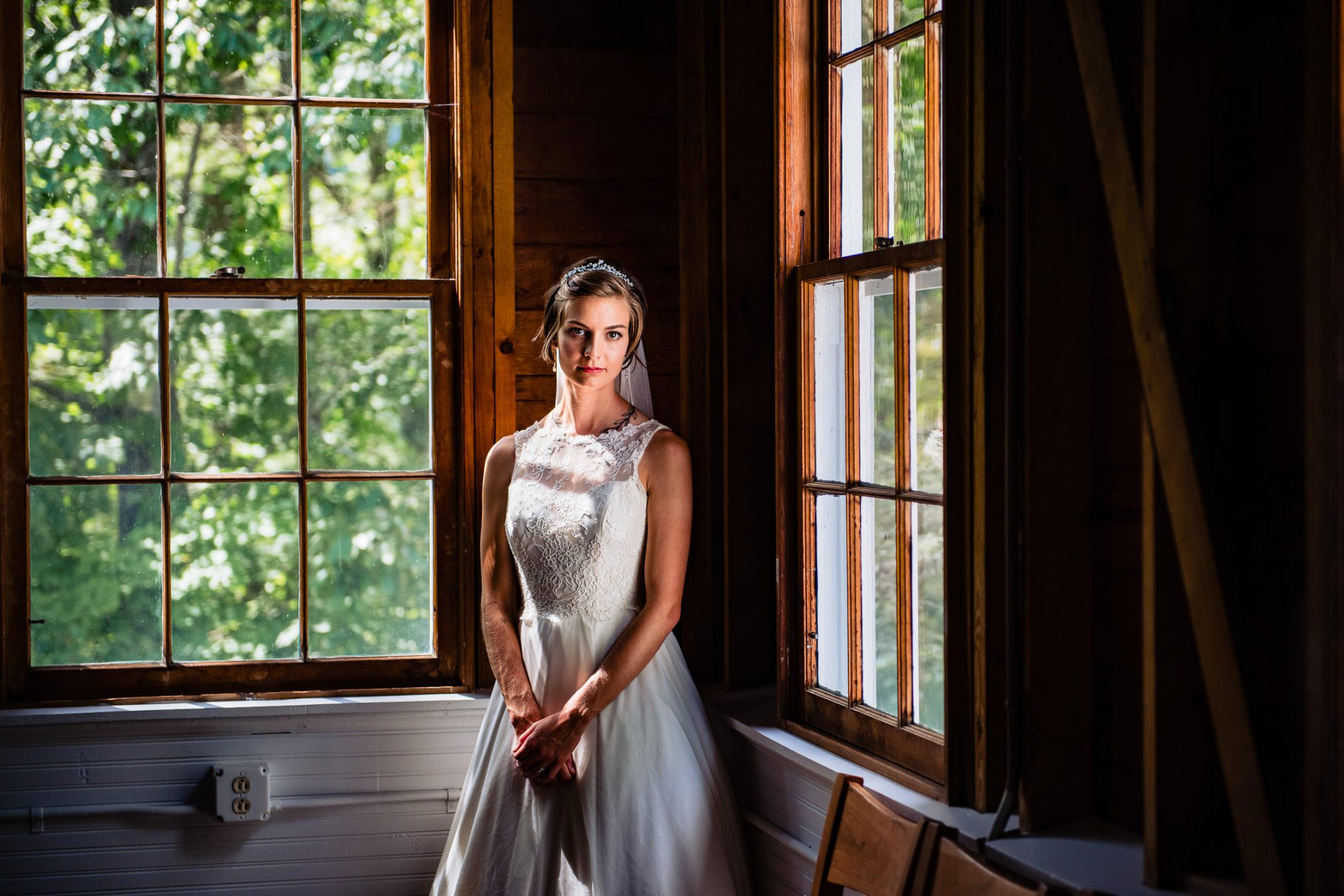 bridal portrait by cabin windows