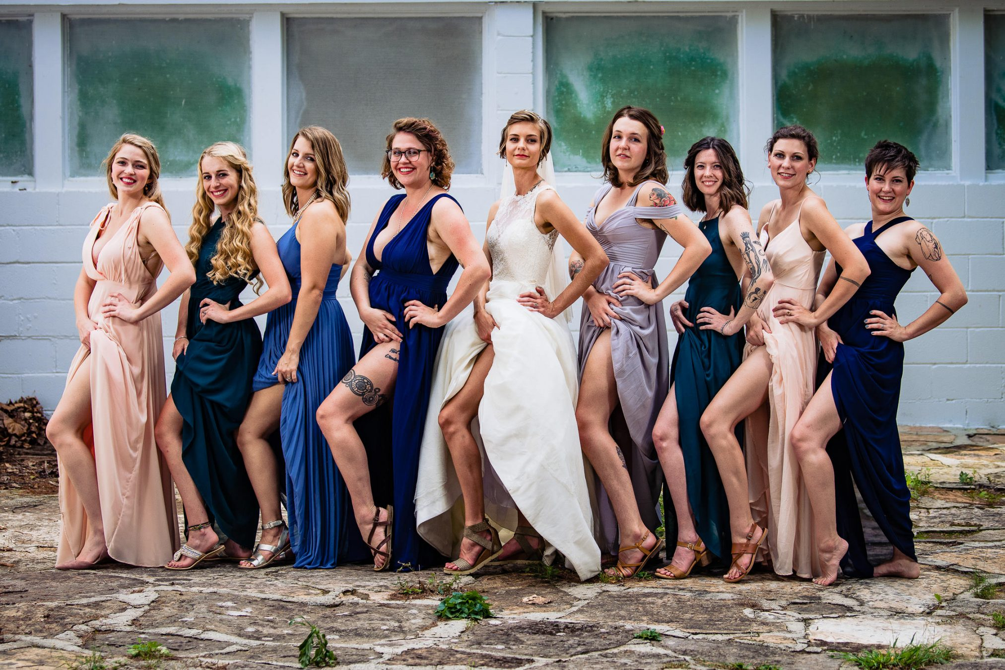 bride and bridesmaids showing off legs