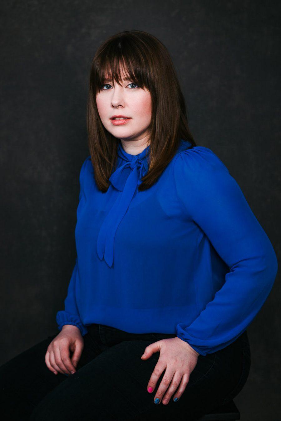 Studio Portrait In Blue Top